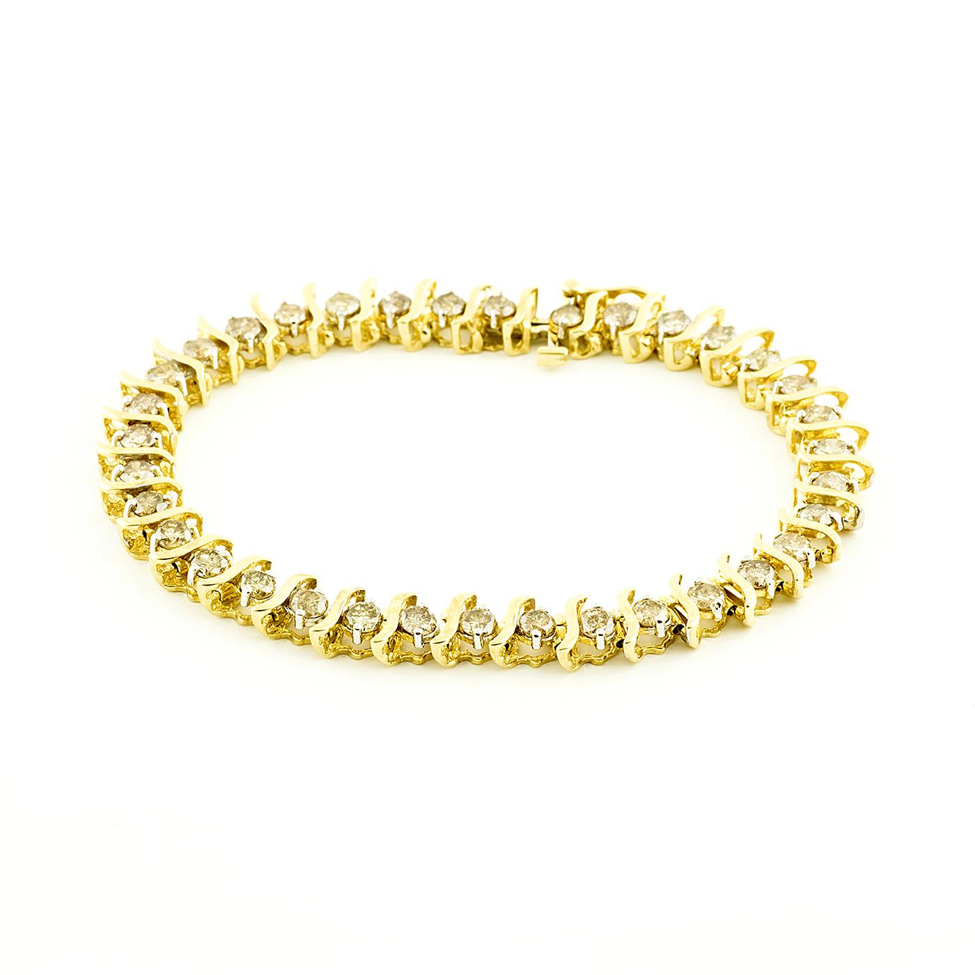 Brazalete Riviere, en Oro con 35 Diamantes talla Brillante de 4,55 ct. (CERTIFICADO IGE).