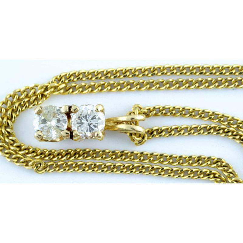 Gargantilla en Oro de 18k con Colgante con dos Diamantes Naturales, talla Brillante, de 0,48 ct. Color K-L. Pureza SI1.