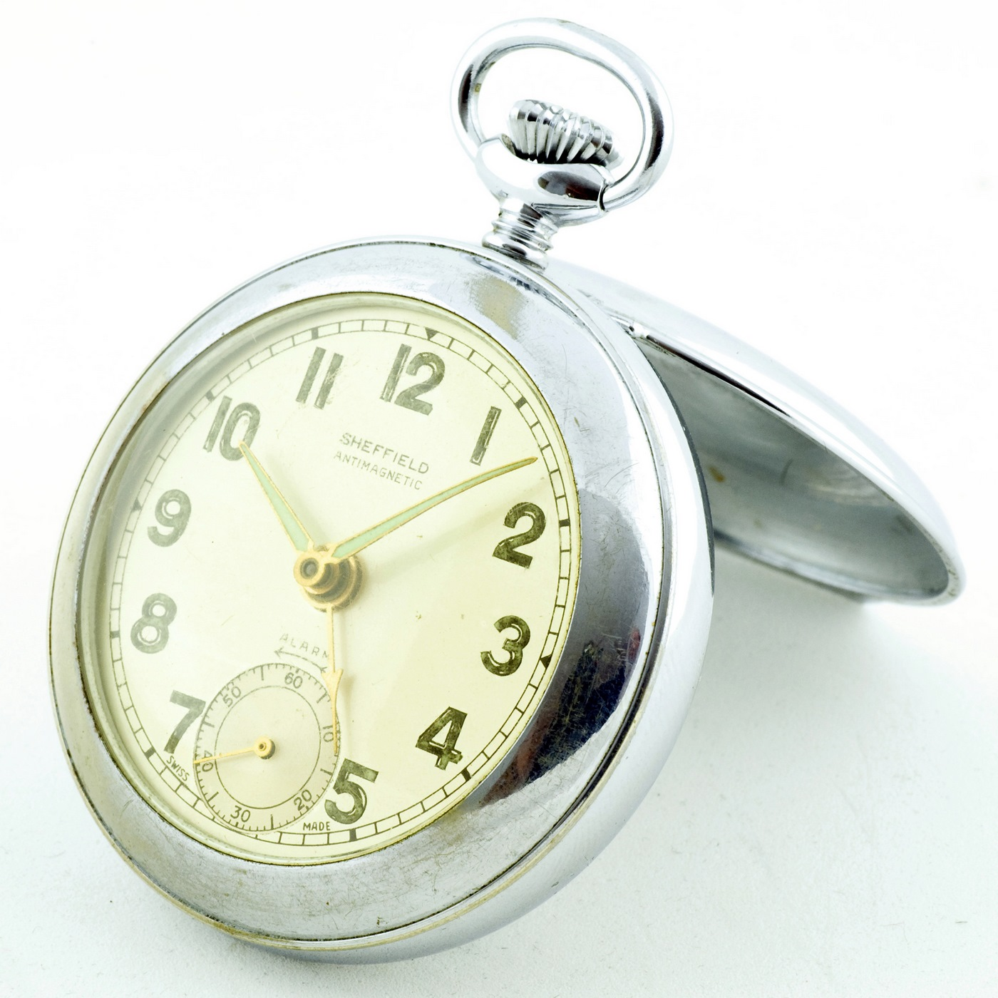 Reloj Suizo Despertador de bolsillo, sobremesa, lepine y remontoir. Sheffield, ca. 1940.