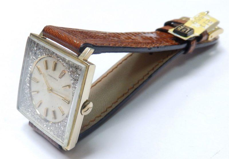 Longines. Reloj-Joya de pulsera para caballero. Oro y Diamantes talla Brillante. Año, 1962.