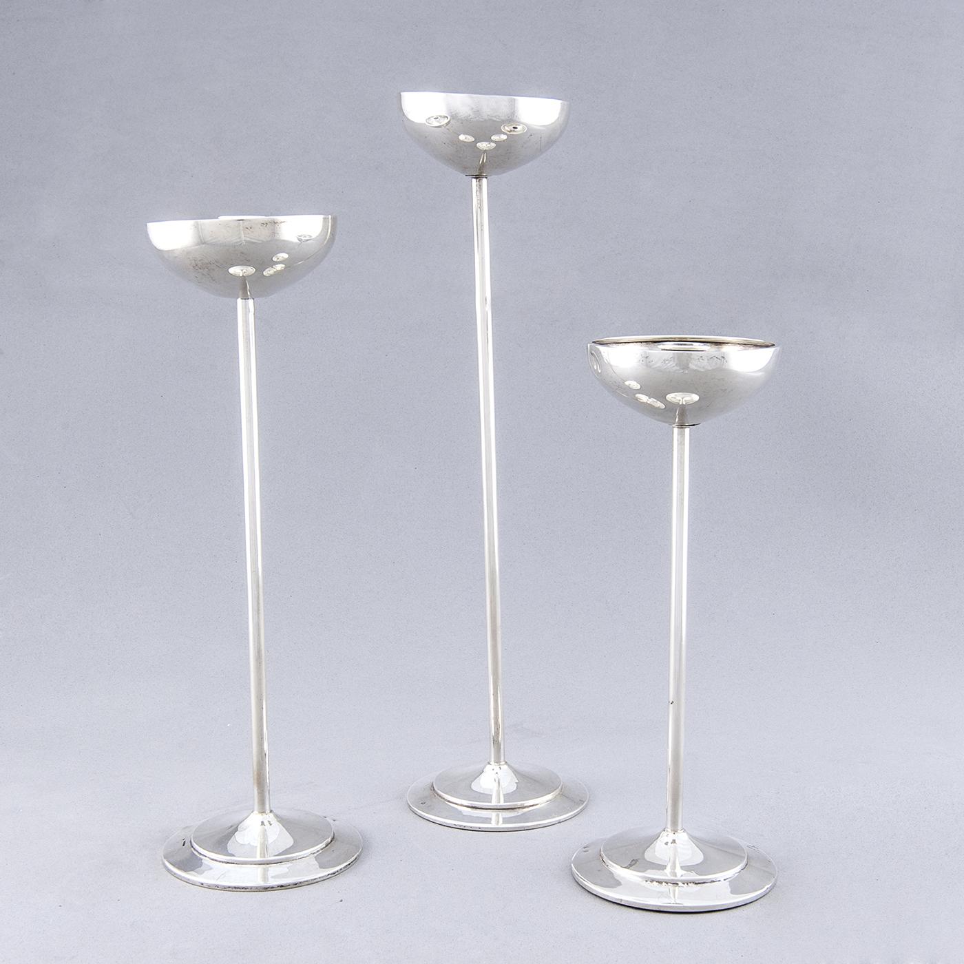 Conjunto de tres candeleros en Plata de Ley, España, siglo XX.