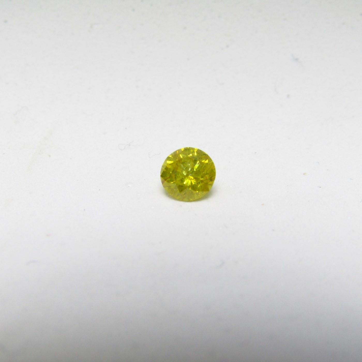 Diamante Natural de 0,58 ct. Talla: Brillante. Color: Fancy Canary Yellow. Pureza: P2. Mejorado. Certificado IGR.